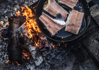 Cooking salmon on bonfire