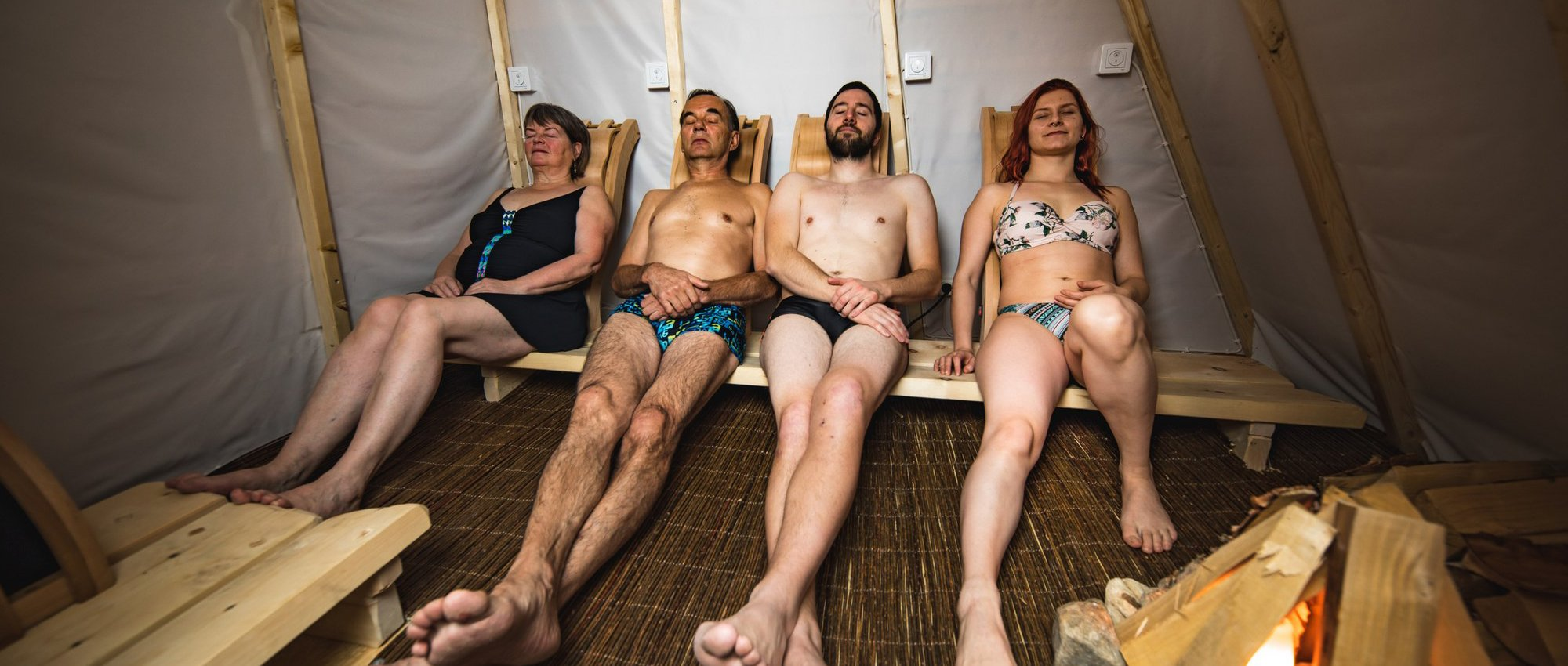 Four people relaxing in Ilmatar Saunna