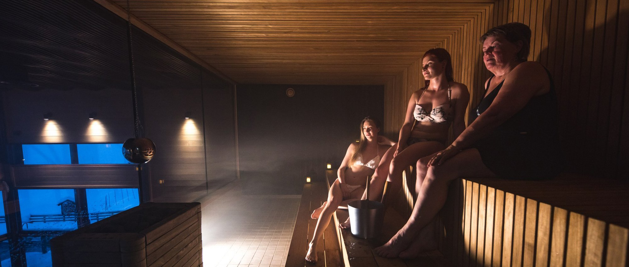 Ladies relaxing in second floor sauna